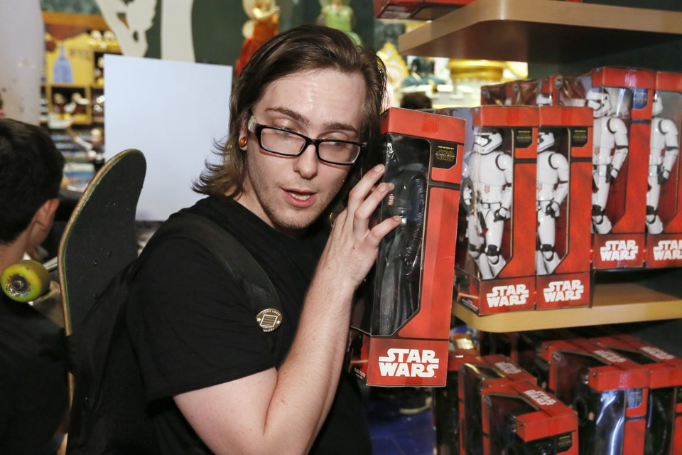 IMAGE DISTRIBUTED FOR DISNEY CONSUMER PRODUCTS - Elijah Catrone, of Queens, N.Y., listens to a talking action figure as Force Friday kicks off at Disney Store in New York's Times Square, Friday, Sept. 4, 2015, to celebrate the launch of merchandise for Star Wars: The Force Awakens. (Photo by Stuart Ramson/Invision for Disney Consumer Products/AP Images)