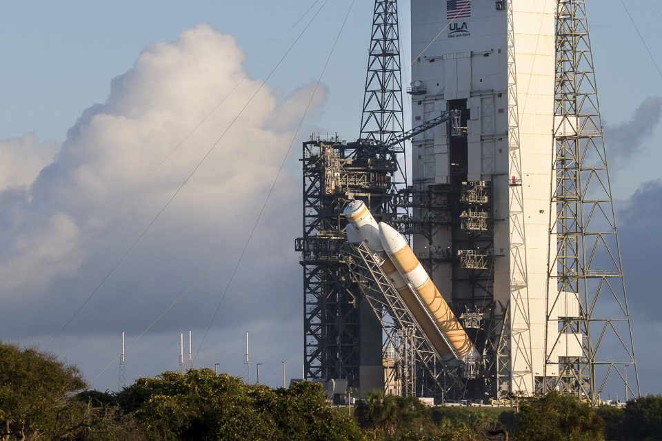 A view of the United Launch Alliance Delta IV Heavy rocket in preparation for the first flight test of NASA's new Orion spacecraft at Cape Canaveral Air Force Station, Florida October 1, 2014. The launch vehicle was moved from the Horizontal Integration Facility to the launch pad at complex 37 at Cape Canaveral Air Force Station and it is being raised to its vertical position.    REUTERS/Mike Brown    (UNITED STATES - Tags: SCIENCE TECHNOLOGY) - RTR48J8T