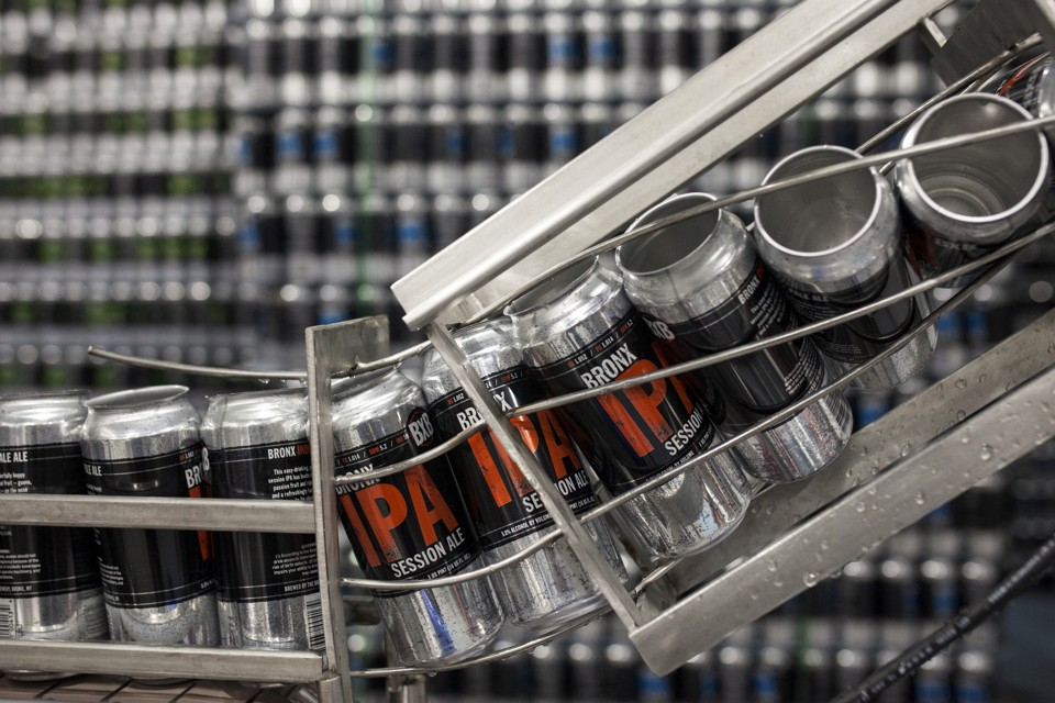 Empty cans wait to be filled with Bronx IPA Session Ale beer at the Bronx Brewery in the Bronx borough of New York, United States, March 5, 2015. The popularity of craft beers has grown rapidly in recent years in the United States as drinkers seek new tastes, with sales estimated to have climbed more than a fifth in 2014. U.S. sales of craft beer in 2014 were worth nearly $20 billion, according to U.S. industry body the Brewers Association, up more than 22 percent from the previous year and accounting for nearly a fifth of all beer sold in the country. Picture taken March 5, 2015. REUTERS/Sara Hylton - RTX1JGVB