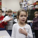 First grade student Livie Classenn recites the Pledge of Allegiance to start the day at the  Walton Rural Life Center Elementary School, in Walton, Kansas, January 18, 2013. Students at the school do farm chores at the beginning of each school day. The Walton Rural Life Center - a kindergarten through fourth grade  charter school in rural Kansas - uses agriculture to teach students about math, science, economics.  REUTERS/Jeff Tuttle (UNITED STATES - Tags: EDUCATION AGRICULTURE SOCIETY) - RTR3DVPT