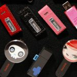 A variety of flash drives by Sandisk are displayed at the Consumer Electronics Show CES Unveiled event in Las Vegas, Nevada January 5, 2008. The show opens January 7th. REUTERS/Rick Wilking (UNITED STATES) - RTX59DB
